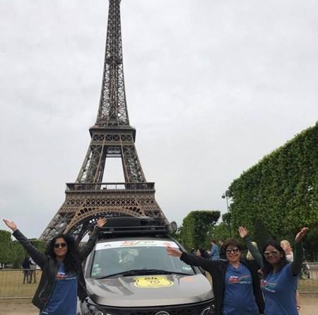 From L: Meenakshi Arvind, Priya Rajpal and Mookambiga Rathinam in front of the Eiffel Tower in Paris.