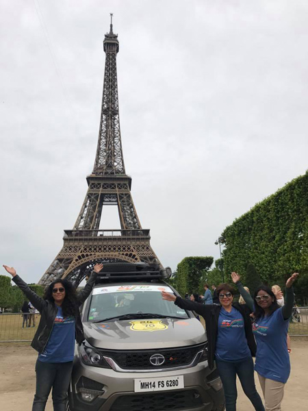 From L: Meenakshi Arvind, Priya Rajpal and Mookambiga Rathinam in front of the Eiffel Tower in Paris.
