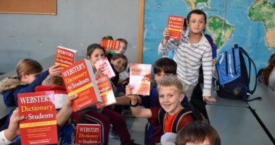 Students hold up dictonaries they received from TBM Rotary Club whose members distributed reference books to all third graders in Topsfield, Boxford and Middleton for the 20th consecutive year. Photo: Submitted