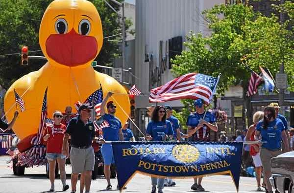 Perhaps the most visible symbol of the Pottstown Rotary Club's service to the community, is the giant inflatable duck that makes its way down High Street every July to promote the Rotary Duck Race that raises thousands of dollars for area organisations. Photo: Digital First Media