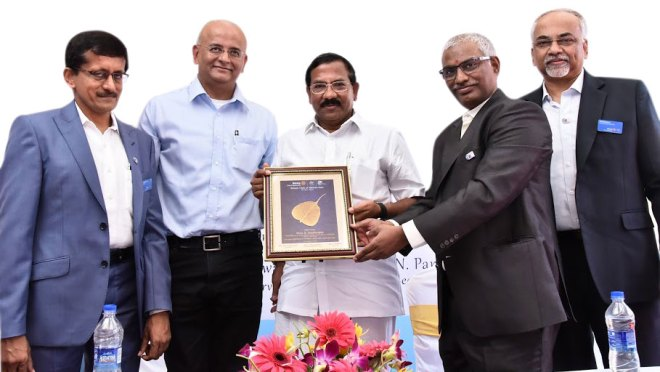 RC Madras East President B S Purushotham (second from R) ­honours State Minister for Tamil Language and Culture K Pandiarajan in the presence of (from L) Club Secretary Paparao Nalluru, IPP K Ananth and Vocational Service Director S Parameswar.
