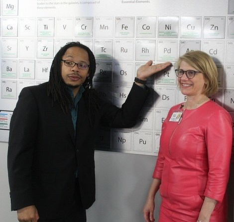"Downtown State College Rotary Club president Jason Brown and past president Tracy Sepich display the element the club ""adopted"" at Discovery Space Centre."