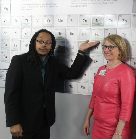 """Downtown State College Rotary Club president Jason Brown and past president Tracy Sepich display the element the club """"adopted"""" at Discovery Space Centre."""