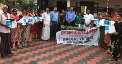 Rotarians distribute grow bags to the residents in a locality in Alleppey.