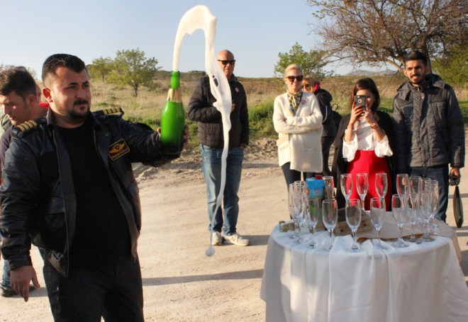 Captain Mehmet opens the bubbly to celebrate the completion of a successful ride.