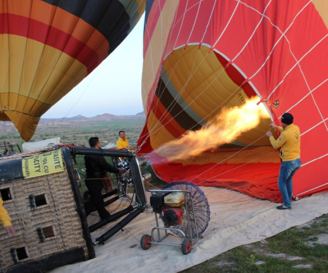 Propane gas is blown into the balloon and heated to make it rise.