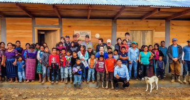 Guatemalan villagers join with volunteers from the Hands for Peacemaking Foundation outside the school the Everett-based nonprofit helped build last month in the village of Canton Maya Jaguar. Photo: Larry Jubie