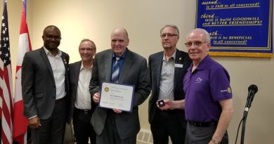 Randy Whitter is given an honorary award by P.A. Rotary. He's flanked by (left to right): Club President Dr Nnamdi Ndubuka, Rotarians Clint Thierman and Les Mewis, and District Governer Peter Neufeldt. Photo: Submitted by Rotary Club of Prince Albert