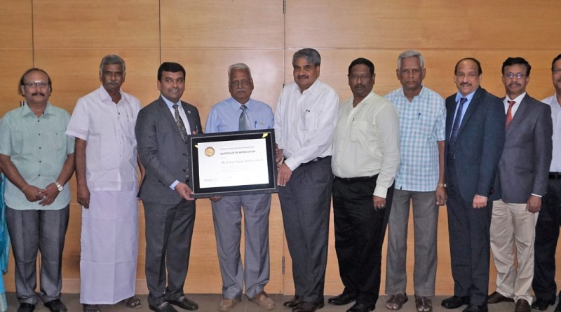 District 3000 Governor P Gopalakrishnan presenting a TRF citation to KVB Chairman B Swaminathan and Managing Director P R Seshadri. Also seen are District General Secretary M Balaji (extreme left), PDG S Rajendran (fourth from left) and District Admin Secretary L Subbiah (extreme right).