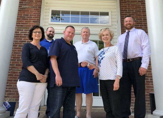 The Rotary Club of Bluefield made a donation to Recovery Point in Bluefield as part of the club's service projects. Rotarian Teresa Paine gives a cheque to the drug rehab facility's director, Terry Danielson. Also pictured are Rotarians Teresa Robinson, club President John Beckett (centre back) and BJ Bauer (right). The club donated money as well as needed supplies for the residents. Photo: Charles Boothe