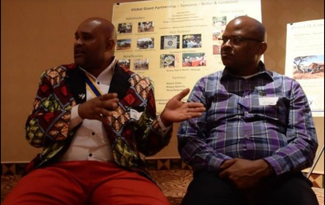 Tanzanian Rotarians explain the water projects to the members of Ames Rotary in the US.