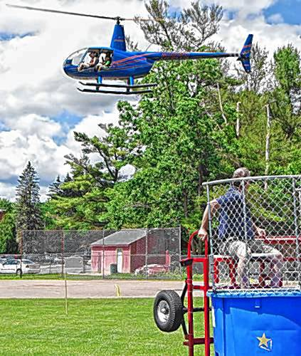 The helicopter rides, a popular attraction at the Athol-Orange Rotary Club's Summerfest last year, will be offered again at the Athol High School.
