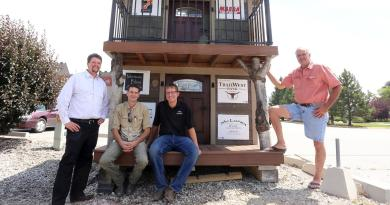 Rotary Club of Hamilton is raffling off a kids' playhouse as a fundraiser for the club. Chris Edwards, Jesse Evans, Jeff Wolfe and Steve Kice all had a part in building the playhouse. Photo: Perry Backus