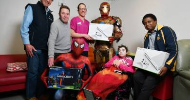 Burnie Rotary's George Austin, John Glen and Themba Bulle with assistant nurse unit manager Allira Riley, hospital heroes Ironman and Spiderman and Lily Wichs, 13. Photo: Brodie Weeding