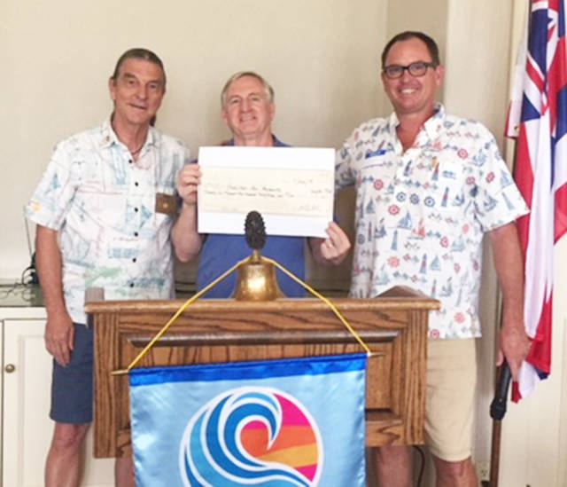 Rotary Club of Hanalei Bay donates $26,000 to Kauai Habitat for Humanity. From left are Club President Ben Gillikin, Kauai Habitat for Humanity Executive Director Stephen Spears and its Community Relations Officer Christopher Young. Photo: Chris Young