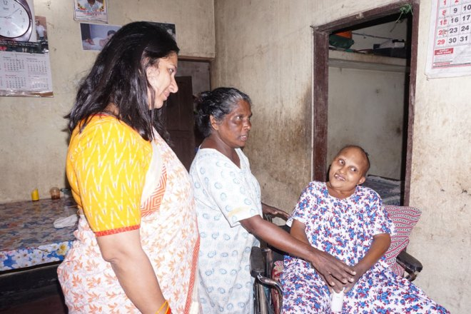 Rtn Nisha Mani visits Josimol Jose, an autistic patient she rescued during the floods.