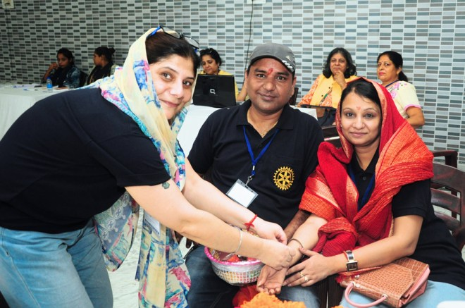 Rotarians celebrate Raksha Bandhan at the LN-4 Hand camp site.