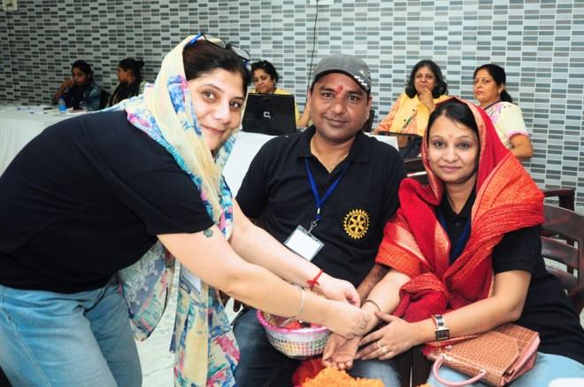 Rotarians celebrate Raksha Bandhan at the LN-4 Hand camp site.