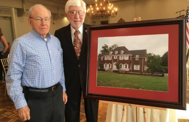A picture of the original Rotary International Study Centre is presented by Rotarians Omar Smith, Rotary Club Director for International Service, and Frank Deaver, who was in charge of publicity when the centre was dedicated in 1973. Photo: Submitted