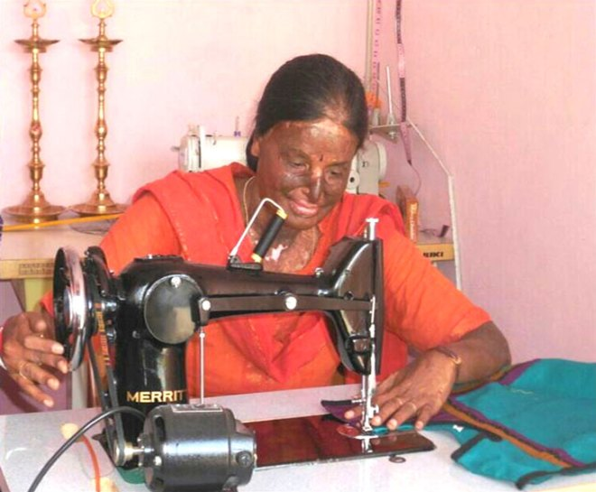 Kavitha, now an entrepreneur, running her tailoring unit.