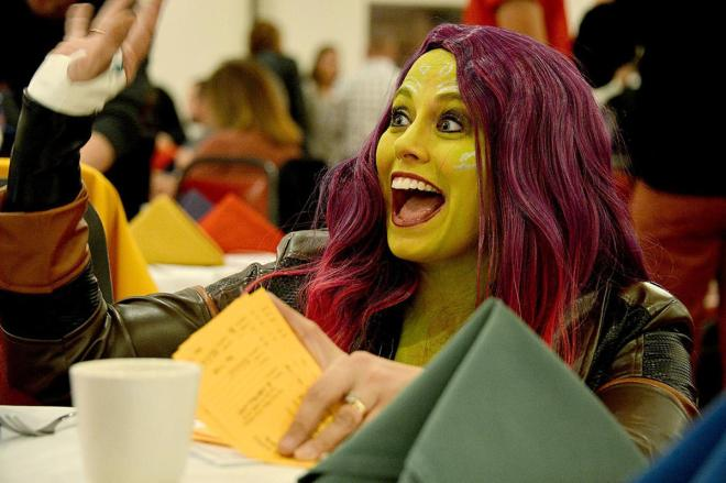 Attorney Kandace Carpenter, 32, of Funkstown pauses from filling out raffle tickets on Sunday to wave during Rotary's dinner and auction. She was dressed as Gamora from 'Guardians of the Galaxy' for the superheroes theme.