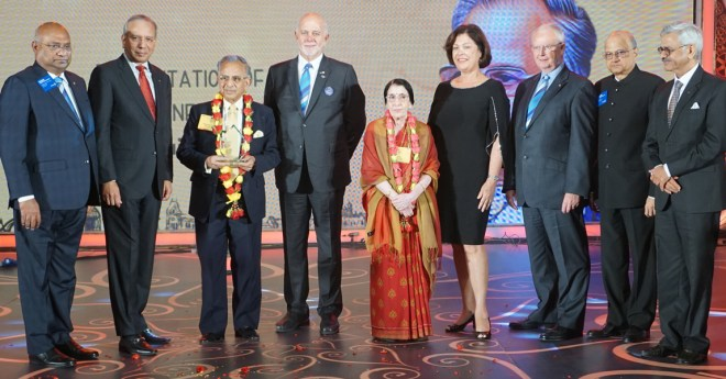 PRIP Rajendra K Saboo and Usha being honoured with the PolioPlus Pioneer Award in the presence of (from L) RID C Basker, PRIP K R Ravindran, RI President Barry Rassin, Esther, TRF Trustees Mike Webb and Gulam Vahanvaty, and INPPC Chairman Deepak Kapur.