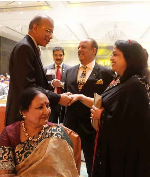 PRIP K R Ravindran greets Rashi and PRID Shekhar Mehta. Vanathy Ravindran and PDG B M Sivarraj are also seen.