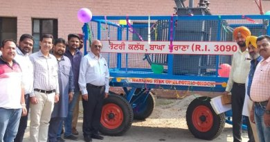 Rotarians with the Transformer on Wheels at a site.