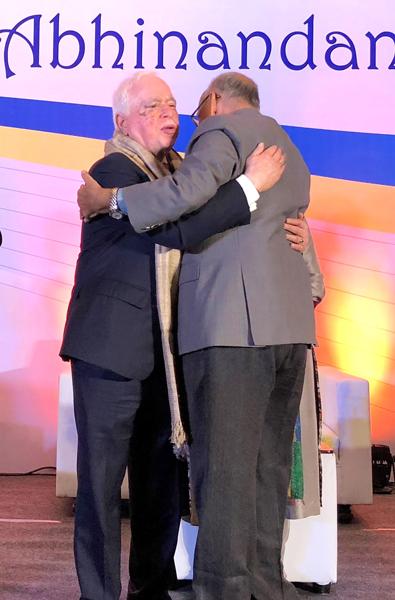 PRIP Kalyan Banerjee gives a warm hug to RIPN Sushil Gupta.