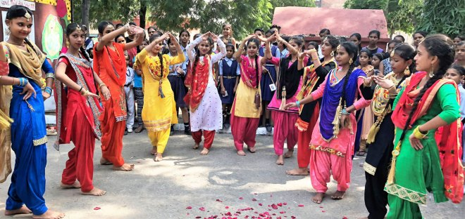 Schoolgirls from the Government Model School, Manimajra, do a Bhangra performance for the visiting RI President Barry Rassin.