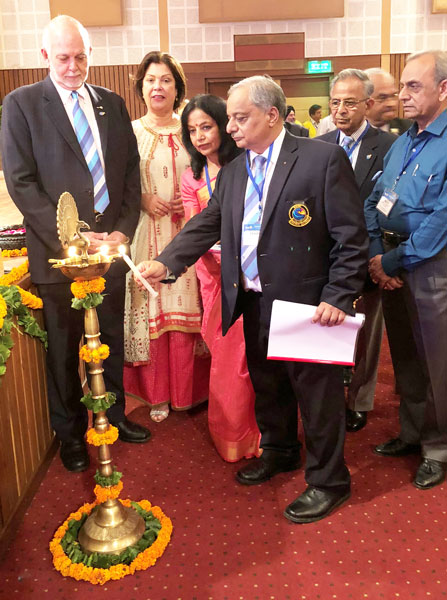 DG Praveen Goyal and Basu light a lamp at the intercity Rotary clubs' meet in the presence of President Rassin and Esther and PRIP Rajendra Saboo.