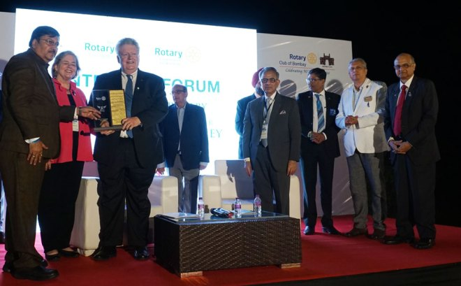 DG Shashi Sharma presents a memento to RIPE Mark Maloney and Gay at the InterCity Forum. Also present: PRIP Rajendra Saboo, TRF Trustee Gulam Vahanvaty, PDG Mohan Chandravarkar, D 3142 DG Ashes Ganguly and PRID Ashok Mahajan.