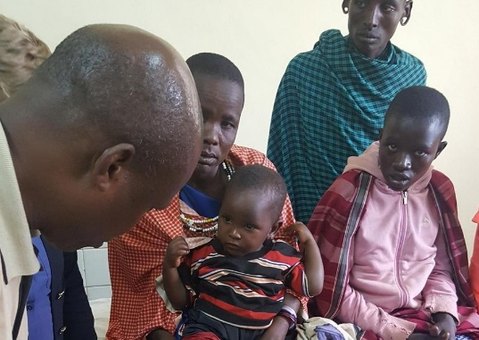 The Lake Travis Rotary Club is asking for donations to fund its 3D limb project and Africa's Promise Village efforts in Tanzania. Shown here, a doctor in Tanzania looks at a baby's deformed leg. Photo: RC Lake Travis
