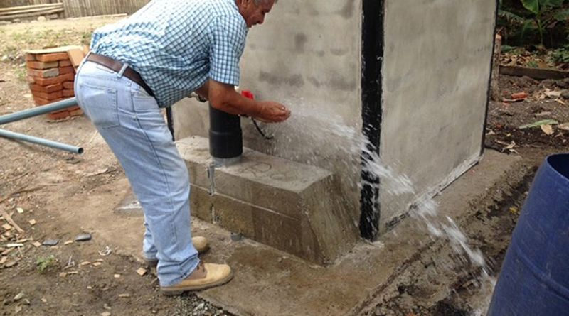 An Ecuadorian tries out the clean water coming from the El Palmar water project completed by another Rotary Club in 2017. Photo: Submitted