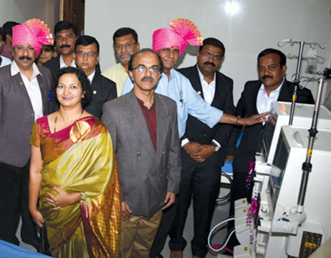 Handing over of dialysis machines at the B A Birnale Hospital. PDG Anand G Kulkarni (left) is in the picture.