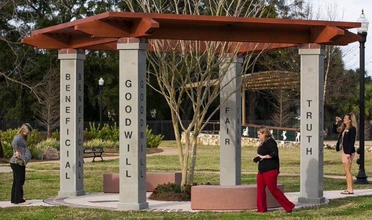 People admiring the arbour donated by RC Ocala which is celebrating its centenary. The arbour stands at Tuscawilla Art Park and etched on its pillars are words summarising the Rotary's 4-Way-Test. Photo: Doug Engle, ocala.com