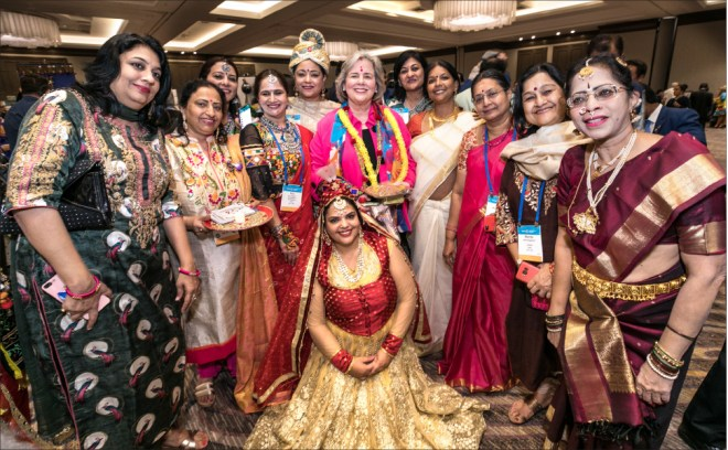 The spouses of incoming District leaders with Gay Maloney at the IA. Sonal Sanghvi and Mala Basker are also present.