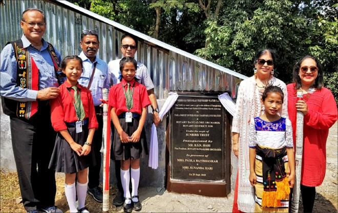 Col Rego, Ravishankar, his business partner B S N Hari, Sunanda Hari and Paola Ravishankar at the inaugural of the water tank in Ijeirong hostel.