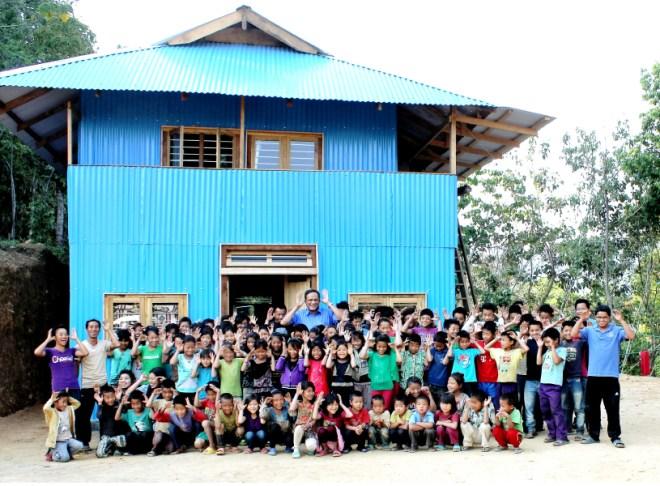 Col Rego with children at the Sunbird Friendship Hostel in Ijeirong.