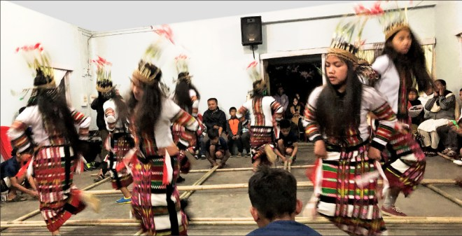 Girls perform the traditional bamboo dance.