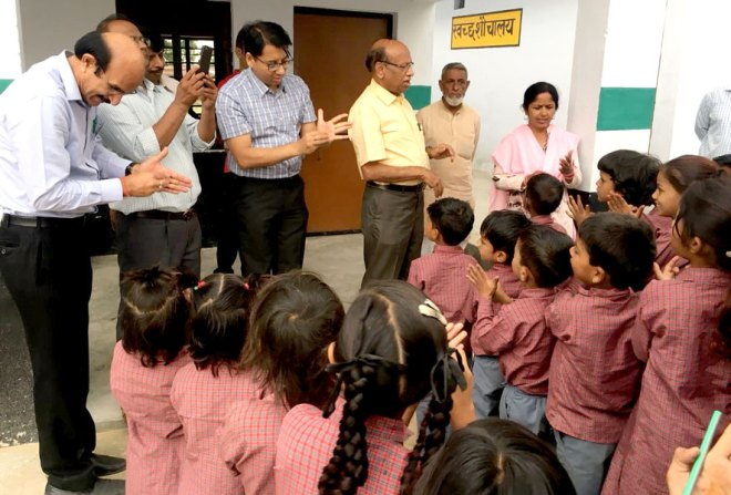 Rotarians of RC Kashipur teach children the right ­handwash method.