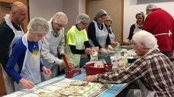 Volunteers at last year's Outreach Hunger event sponsored by Northampton County's Rotary Clubs assemble meals for distribution to food banks and other agencies. Photo: Ron Searfoss