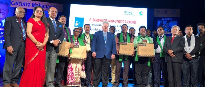 From L: DG Mukul Sinha, RC Calcutta Mahanagar President Chitra Agarwal, RIDE Kamal Sanghvi, RIPE Mark Maloney (centre) and Rtn Pradeep Rawat after distributing e-learning kits to school representatives.