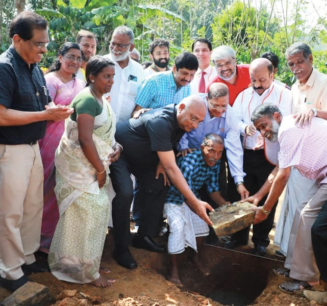 RID C Basker lays the foundation stone for a home in Wayanad, in the presence of D 3202 DG E K Ummer, PDGs E K Sagadhevan and P M Sivashankaran.