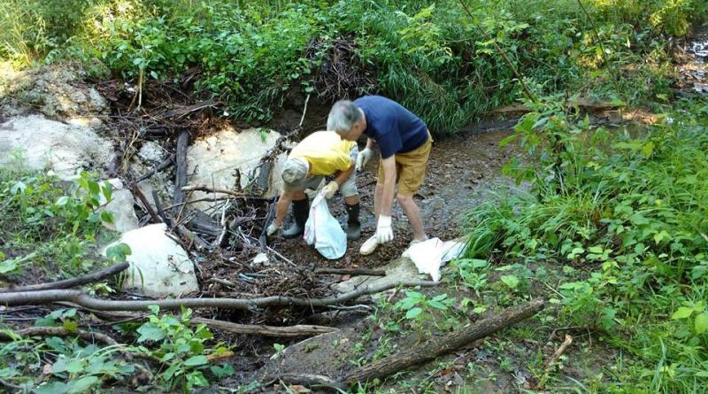 Members of the Rotary Club of Mansfield participate in biannual stream cleanups in the city.
