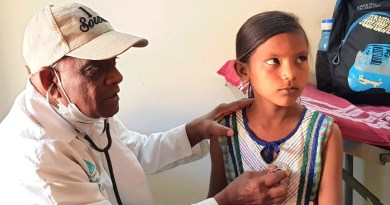 A child being examined by a doctor at the Rotary medical camp.