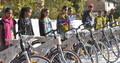 Students with their new bicycles.