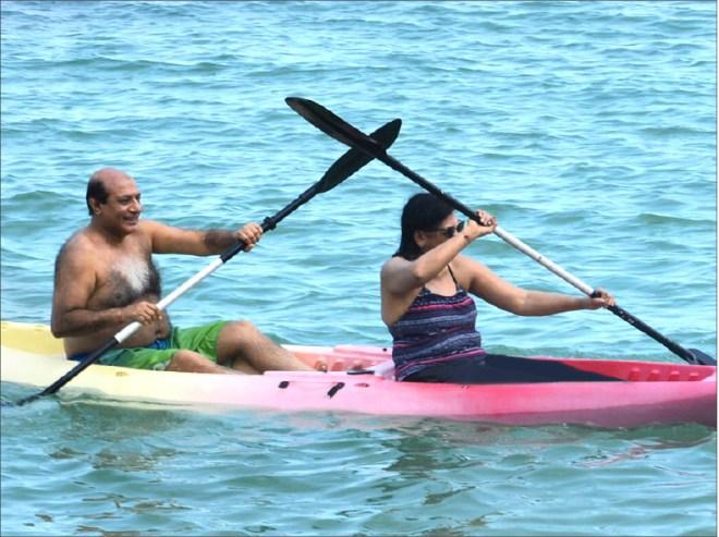 Kamal Sanghvi and Sonal rowing a canoe in Koh Samui, Thailand.