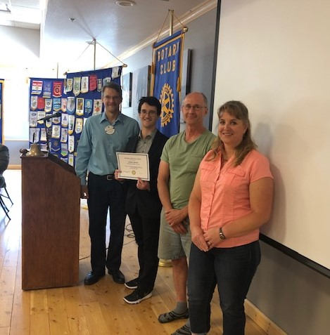Rotary Club President Vincent Chiravalle with Distinguished Student of Service Joshua Shevitz; his father, Danny Shevitz; and high school language arts teacher Lori Thompson. Photo: Linda Hull