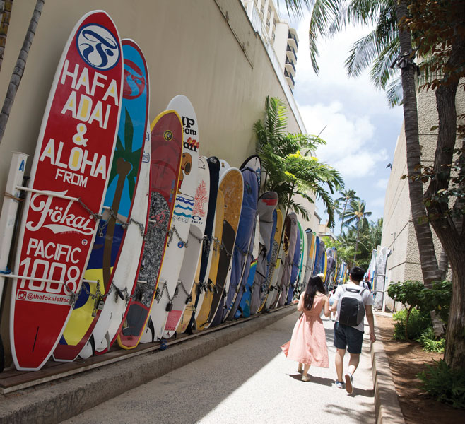 Colourful surfboards of varying sizes are an omnipresent reminder of Hawaiian culture.